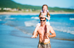Father and daughter on the beach Royalty Free Stock Image