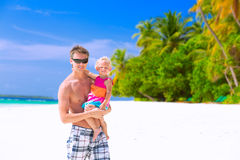 Father with daughter on the beach Royalty Free Stock Photography