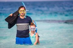 Father and daughter at beach. Father and his adorable little daughter at beach Stock Images