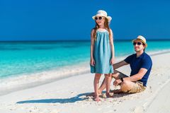 Father and daughter at beach. Father and his adorable little daughter at beach Stock Photos