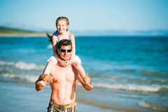 Father and daughter on the beach Royalty Free Stock Images