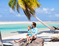 Father and daughter on a beach vacation Stock Photo