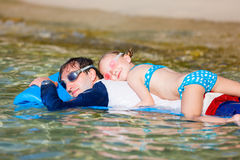 Father and daughter on beach vacation Stock Images