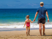 Father and daughter on the beach Royalty Free Stock Photo