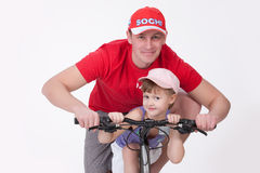 Father And Daughter On The Bicycle Stock Photo