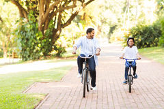Father daughter bike together stock images