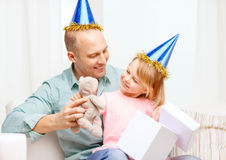 Father and daughter in blue hats with gift box Royalty Free Stock Photography