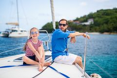 Family on board of sailing yacht. Father and daughter on board of sailing yacht having summer travel adventure stock photo