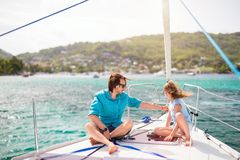 Family on board of sailing yacht. Father and daughter on board of sailing yacht having summer travel adventure royalty free stock photo