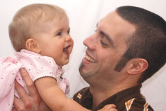 Father daughter bonding time. Close-up of father holding smiling daugher isolated against white background Stock Photos