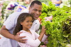 Father and daughter buying fresh produce Stock Photography