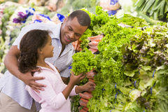 Father and daughter buying fresh produce Royalty Free Stock Images