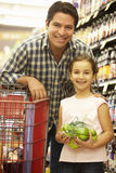 Father and daughter buying fruit in supermarket Stock Image