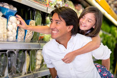 Father and daughter buying groceries Royalty Free Stock Photo