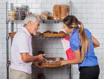 Father And Daughter Buying Muffins. At supermarket Stock Image