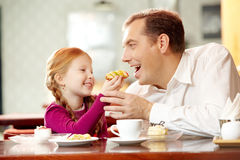 Father and daughter in cafe Royalty Free Stock Photography