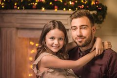 Father and daughter on christmas eve Stock Photo