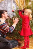Father and daughter with christmas tree Stock Image