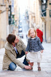Father and daughter in city. Father and his little daughter outdoors in city Royalty Free Stock Photography
