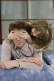 Father and daughter. She closes  his eyes Stock Photography