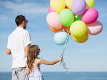 Father and daughter with colorful balloons Royalty Free Stock Photos