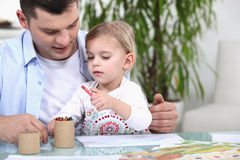 Father and daughter colouring Stock Image