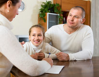 Father and daughter complete a questionnaire Royalty Free Stock Photo
