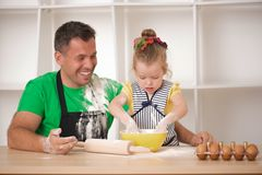 Father and daughter cooking Stock Photography