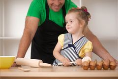 Father and daughter cooking Royalty Free Stock Photos