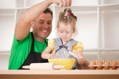 Father and daughter cooking Stock Photo