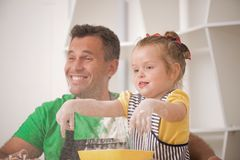 Father and daughter cooking Stock Photos