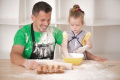 Father and daughter cooking Stock Image