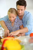 Father and daughter cooking together Stock Photos