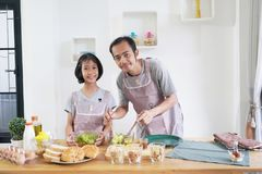 Father and daughter cooks in the kitchen at home Royalty Free Stock Photography