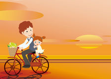 Father and daughter cycling. The setting sun,Father and daughter cycling Stock Images