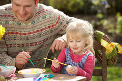 Father And Daughter Decorating Easter Eggs. On Table Outdoors Royalty Free Stock Photos