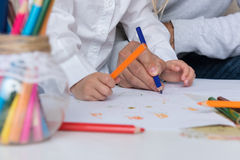 Father and daughter drawing together. Creativity and learning concept Stock Photos