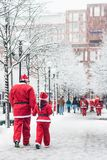 Father and daughter dressed up as santas participate in charity event Stockholm Santa Run in Sweden Royalty Free Stock Image