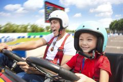 Father and daughter driving go kart stock images