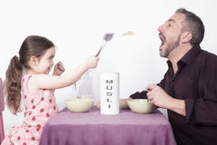 Father and daughter eating Muesli Royalty Free Stock Images