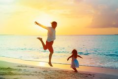 Father and daughter enjoy beach vacation play at sea. Beach Stock Photography