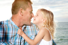 Father and daughter enjoy sunny day at the beach. Royalty Free Stock Photography