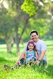 Father and daughter enjoying afternoon in the park Royalty Free Stock Photos