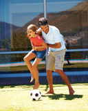 Father and daughter enjoying a game of football Stock Images
