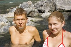 Father and daughter enjoying a hot rock pool stock photography