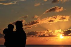 Father and daughter enjoying Sunset Royalty Free Stock Photo