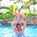 Father and daughter enjoying swimming pool Stock Image