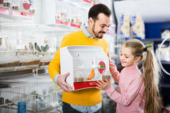 Father and daughter enjoying their purchase of canary bird in pe Stock Photo