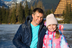 Father with daughter enjoying winter vacations Royalty Free Stock Images