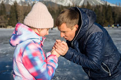 Father with daughter enjoying winter vacations Royalty Free Stock Image